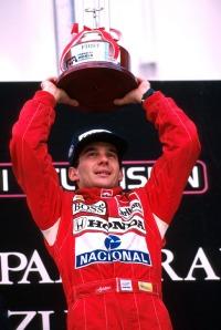 Winner Ayrton Senna (BRA) celebrates his win and world championship on the podium (from footbasket.com.jpg)